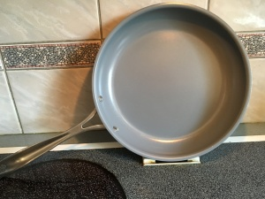 Enamel sealed clad sauté pan.